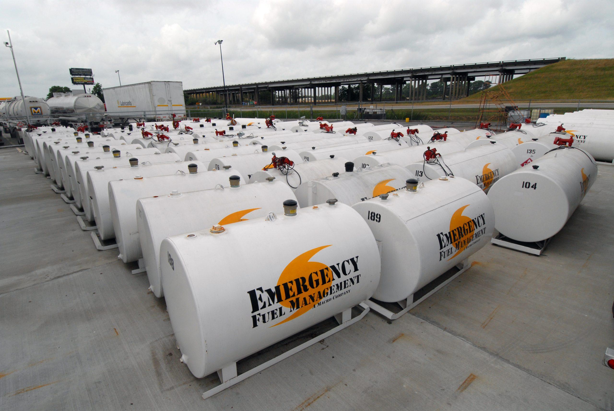 Portable fuel storage tanks on yard